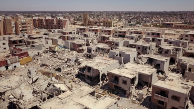 aerials of sirte in libya showing scars of recent conflicts - terra brulla video stock e b–roll