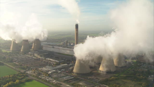 aerials of smoke coming from cooling tower chimneys at drax coal fired power station in selby north yorkshire - smoke physical structure stock videos & royalty-free footage