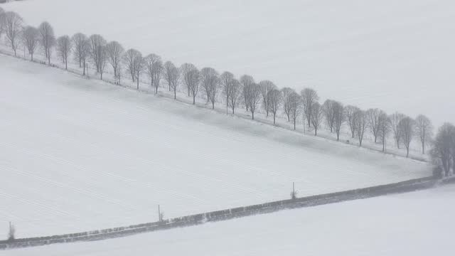 aerials of snow over kent; england: kent: ext / snow on ground air views snow-covered fields / church and houses / snowy countryside - deep snow stock videos & royalty-free footage