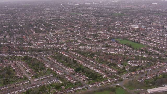 aerials of south west london showing built up residential area in suburbs of london - city life stock videos & royalty-free footage