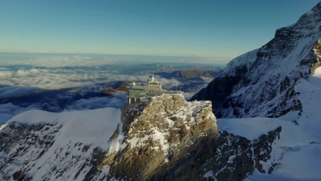 aerials of sphinx observatory, switzerland - high up stock videos & royalty-free footage