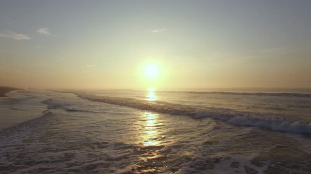 aerials of the beach at dawn. odisha, india. - sunrise dawn stock videos & royalty-free footage