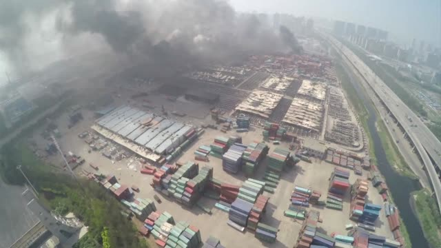 aerials of the site of two massive explosions in the chinese port of tianjin that left scores dead - tianjin stock videos & royalty-free footage