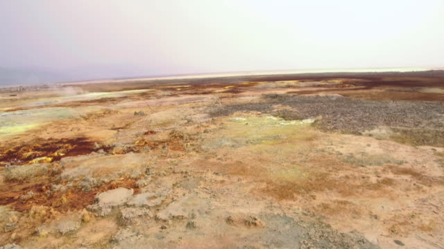 aerials of unusual landscape, dallol, ethiopia - terra brulla video stock e b–roll