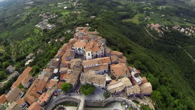"""aerials of village outside rome and military surrounding it as it goes into total lockdown after a cluster of coronavirus cases were discovered there - """"bbc news"""" video stock e b–roll"""