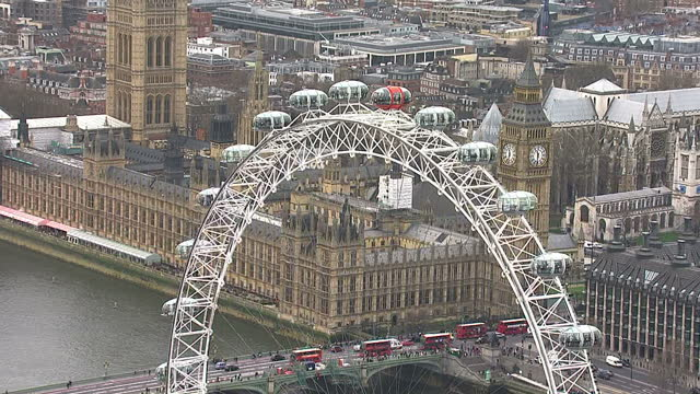 aerials of westminster houses of parliament, london eye and big ben on budget day, union flag or union jack is on display on march 20, 2014 in... - ランベス点の映像素材/bロール