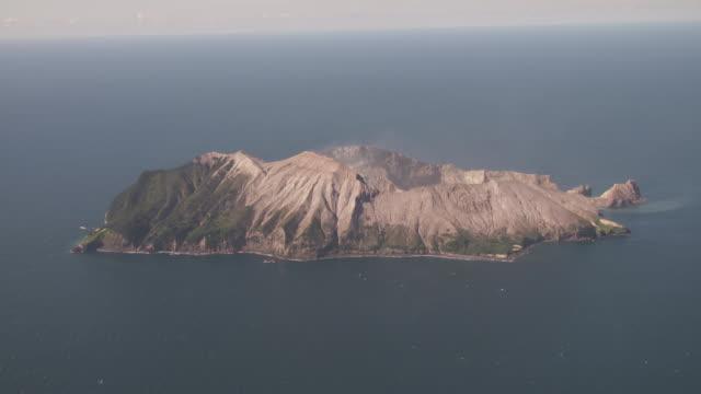 aerials of white island active cone volcano in sea off whakatane bay of plenty new zealand - tectonic stock videos & royalty-free footage