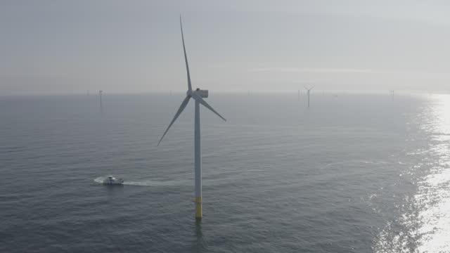 "aerials offshore wind turbine - ""bbc universal"" stock videos & royalty-free footage"