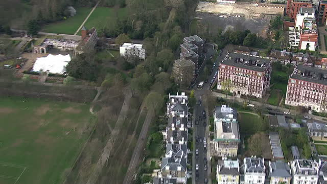 aerials over central london in from the thames river lots of housing and buildings mix of residential and business the boltons with church other... - the serpentine london stock videos & royalty-free footage