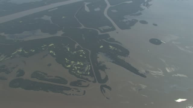 aerials over gulf marshland near bp gulf oil spill at the gulf oil spill spreads damaging economies nature and way of life at grand isle la - oil spill stock videos & royalty-free footage