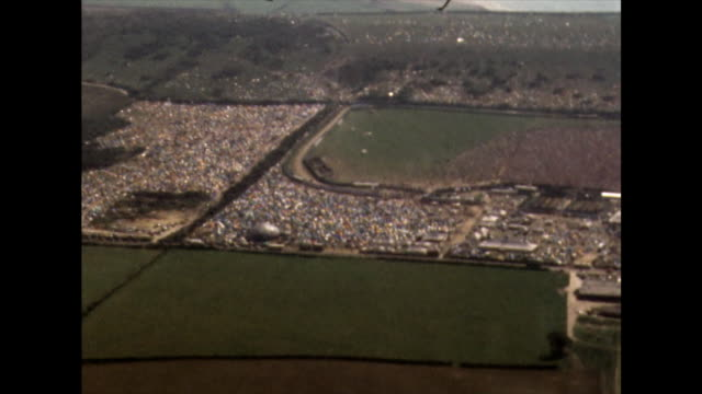 aerials over isle of wight festival site and crowds; 1970 - in front of stock videos & royalty-free footage