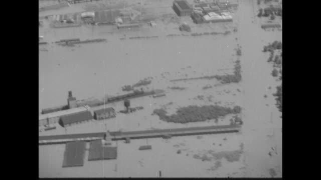 aerials over mississippi river flooding, with treetops, church spires, areas underwater - 尖り屋根点の映像素材/bロール