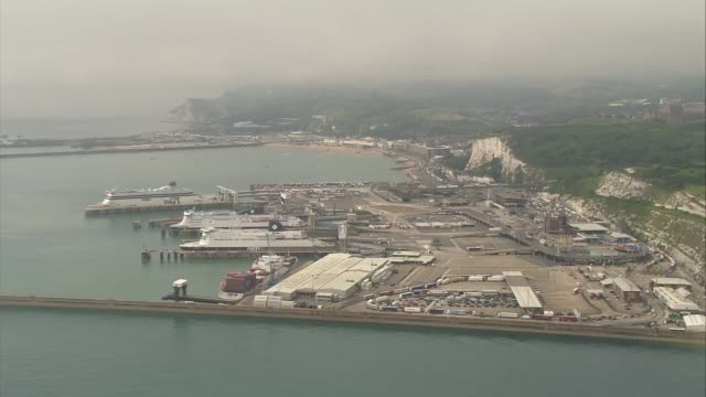 aerials port of dover with traffic jams england kent dover dover ferry terminal / vehicles queuing at ferry check in bays / ferry terminal / long... - dover kent stock-videos und b-roll-filmmaterial
