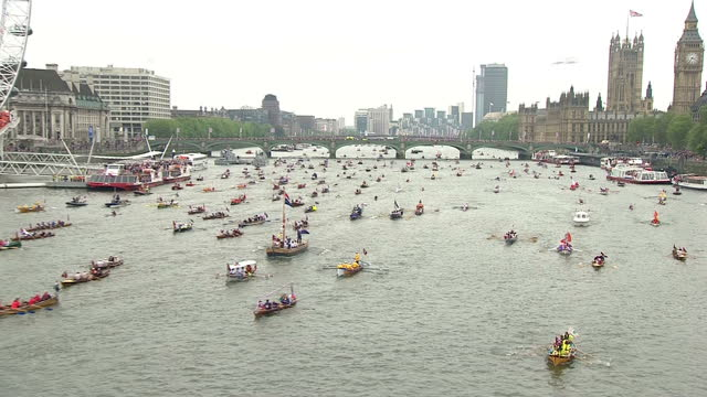 Aerials shots of Flotilla of various boats on River Thames to celebrate Queen Elizabeth II Diamond Jubilee Aerials of Royal Flotilla Pageant on River...