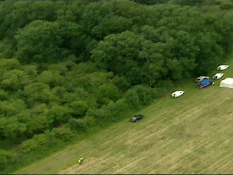 aerials shots of harrowdown hill forrest area in oxfordshire where dr david kelly body was found with police forensic tents at the scene. scene where... - oxfordshire bildbanksvideor och videomaterial från bakom kulisserna