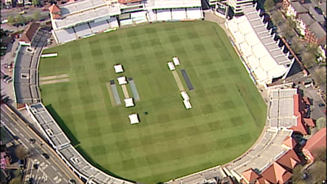 aerials shots of trent bridge cricket ground home of nottinghamshire county cricket club - pan over pitch and pavillion at historical ground ** note... - ゴールを狙う点の映像素材/bロール