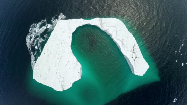 """aerials showing a large c-shaped iceberg - """"bbc universal"""" stock videos & royalty-free footage"""