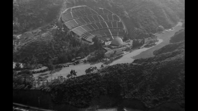 aerials traveling along hollywood freeway beginning with the hollywood bowl aerials of hollywood on january 01 1940 in los angeles california - 1940 bildbanksvideor och videomaterial från bakom kulisserna