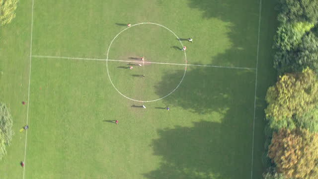 clean aerials views amateur grass roots football being played in a london park amatuer football aerials on july 17 2013 in london england - grass stock videos & royalty-free footage