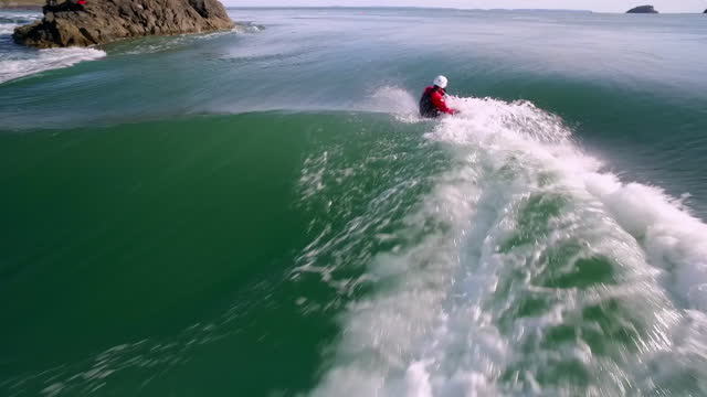 aerials white water kayaker riding waves in sea - oar stock videos & royalty-free footage