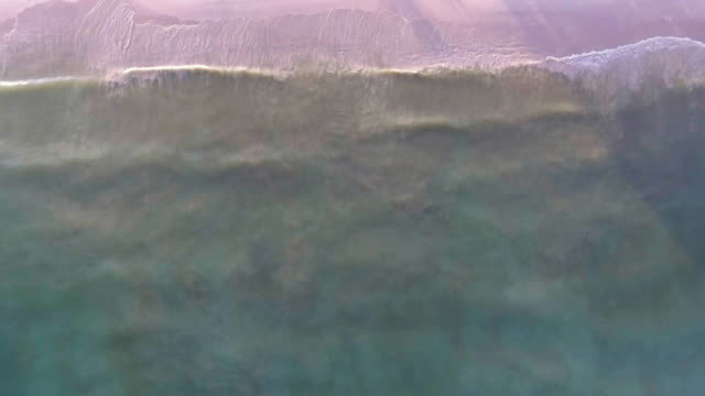 Aerial:Sea wave with sunlight