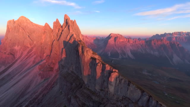 aerial:seceda mountain range at dusk - mountain range stock videos & royalty-free footage