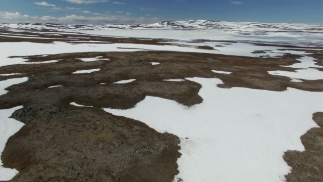 aerial/the tundra-snow melting in the arctic , finnmark, norway - scandinavia stock videos & royalty-free footage