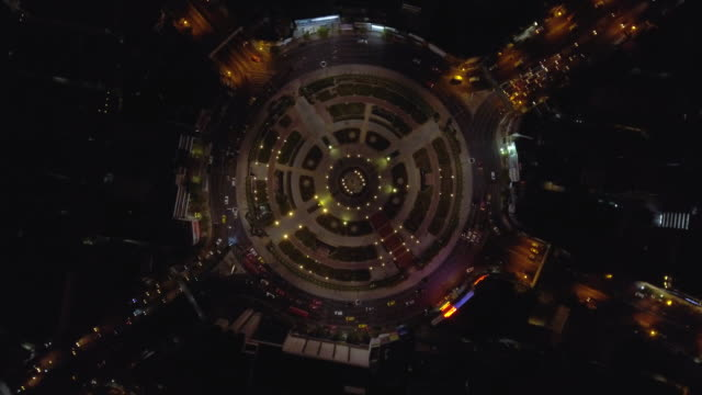 aerial:traffic car in circle at night - roundabout stock videos and b-roll footage