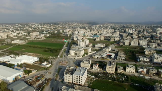 Aerial/Tulkarm Palestinian city with Palestine flag