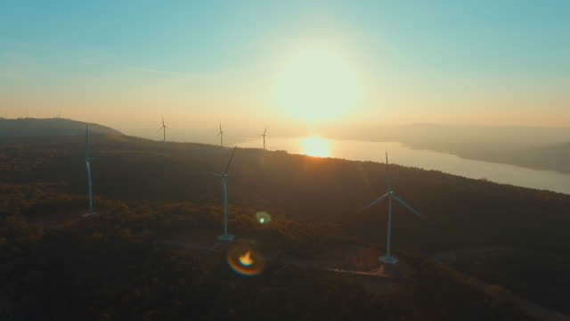 aerial:turbines on wind farm at sunset - questioni ambientali video stock e b–roll