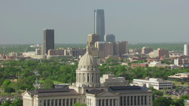 ws aerialview of oklahoma state capitol and downtown buildings in background / oklahoma city, oklahoma, united states - oklahoma stock-videos und b-roll-filmmaterial
