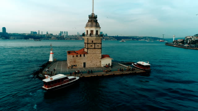aeriel view of boat going to maiden's tower at sunset in istanbul by drone - july 15 martyrs' bridge stock videos & royalty-free footage