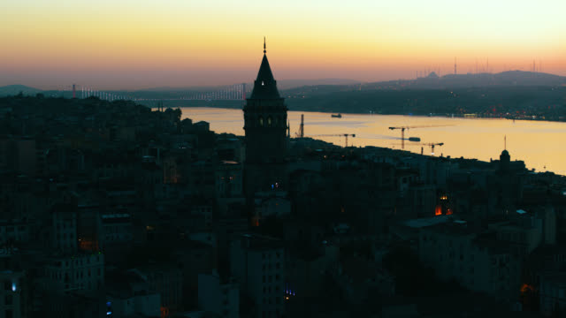 aeriel view of istanbul galata tower, bosphorus and bridge in silhouette - bosphorus stock videos & royalty-free footage