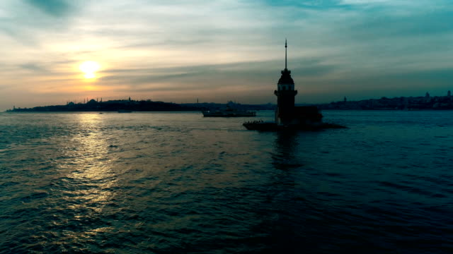 aeriel view of the ferry and the maiden's tower at sunset in istanbul by drone - bosphorus stock videos & royalty-free footage