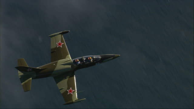 air to air, aero l-39 albatros flying above clouds, overhead view - unknown gender stock videos & royalty-free footage