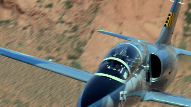 air to air, cu, aero l-39 albatros flying over desert, grand canyon, arizona, usa - コックピット点の映像素材/bロール