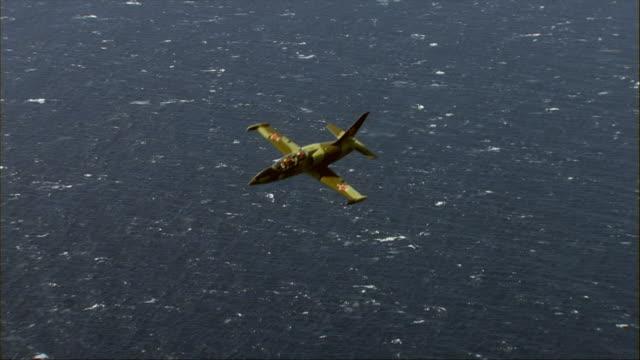air to air, aero l-39 albatros flying over ocean - unknown gender stock videos & royalty-free footage