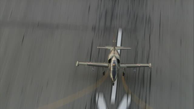 air to air, ms, aero l-39 albatros landing on runway, mojave desert, overhead view, california, usa - unknown gender stock videos & royalty-free footage