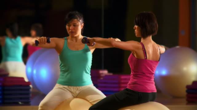 hd dolly: aerobics instructions - aerobics stock videos & royalty-free footage