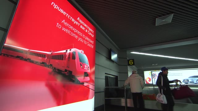 aeroexpress poster by baggage carousel / red sign for train tickets in russian and english / selfservice train ticket machine / machine payment slot... - poster stock videos and b-roll footage