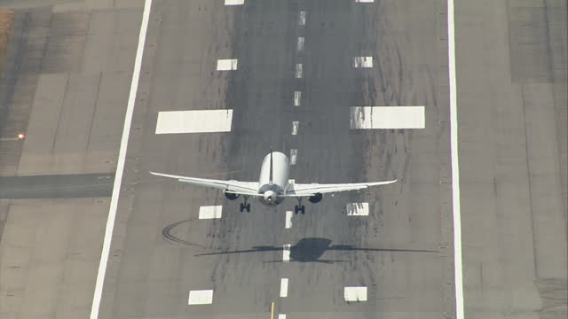 "aeroplane coming into land on runway at uk airport - ""bbc news"" stock videos & royalty-free footage"
