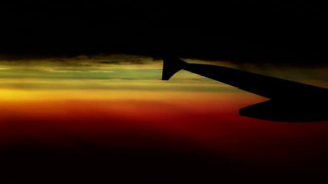Aeroplane flying in sunset sky