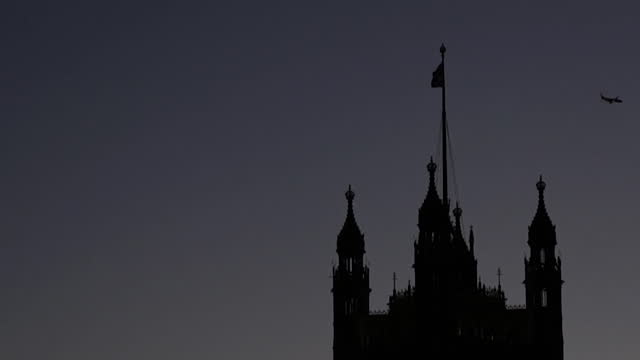 aeroplane flys past houses of parliament - clock tower stock videos & royalty-free footage