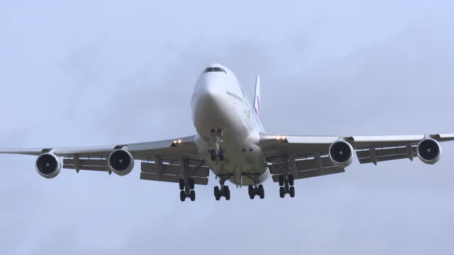 aeroplane landing in wiltshire, carrying diamond princess cruise ship passengers who were quarantined on the ship in japan due to coronavirus - carrying stock videos & royalty-free footage