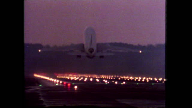 ms aeroplane taking off from a uk airport at dusk; 1980 - aeroplane stock videos & royalty-free footage