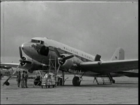 singapore, 1950; aeroplanes at airport - history stock videos & royalty-free footage