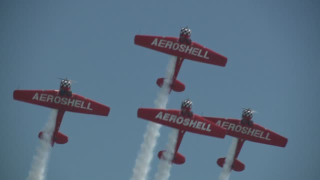 wgn aeroshell aerobatic team performing at 2015 chicago air water show on august 16 2015 in chicago illinois this sixman stunt team has been... - acrobatica aerea video stock e b–roll