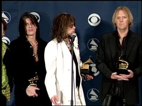 aerosmith at the 1999 grammy awards backstage at the shrine auditorium in los angeles, california on february 24, 1999. - エアロスミス点の映像素材/bロール