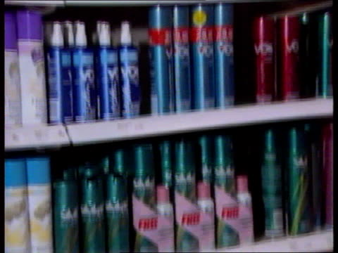 fiftieth anniversary lib england london int aerosol cans of deodorant on shelf in shop cans of aerosol along on factory production line c5l - aerosol can stock videos & royalty-free footage