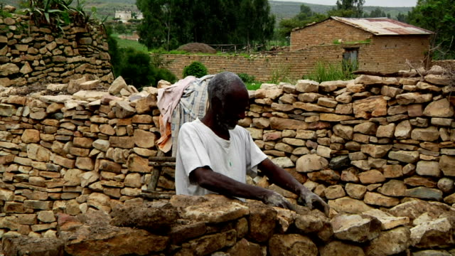 afar men build stone enclosure on august 16 2011 on road from makele to addis ababa ethiopia - enclosure stock videos & royalty-free footage